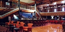 The Atrium Bar has live music and a welcoming vibe onboard a Carnival Cruise.