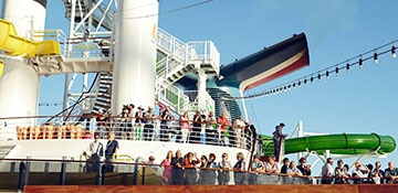 Wave goodbye to onlookers while you dance to a live DJ at the Sail Away Party.