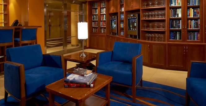 Relax in The Library Bar on Carnival Breeze and enjoy wine tasting via the automated wine concierge.