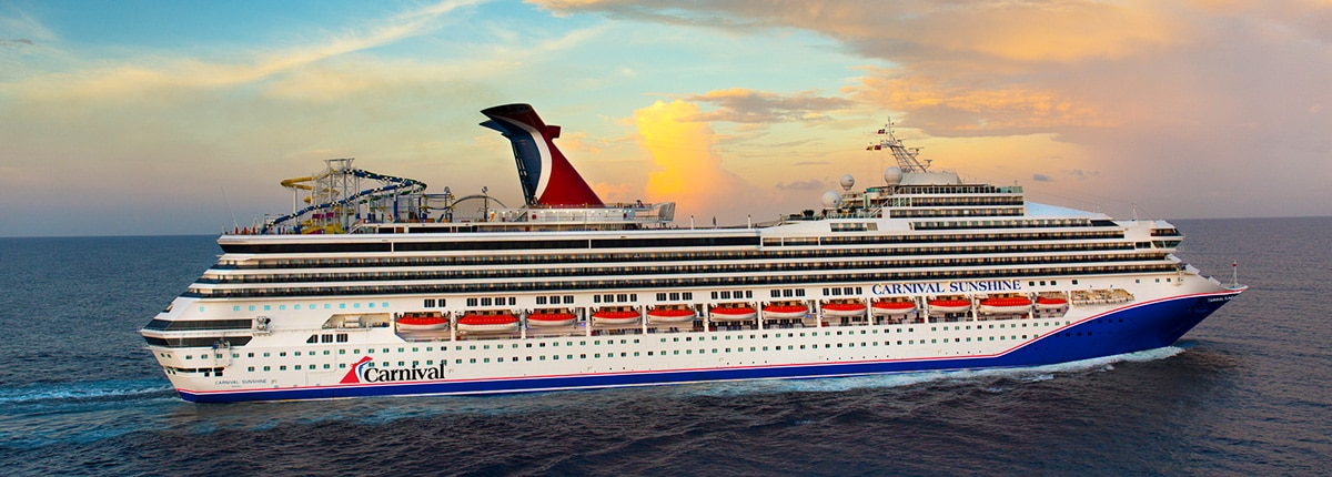 cruise ship carnival sunshine sailing through the blue ocean