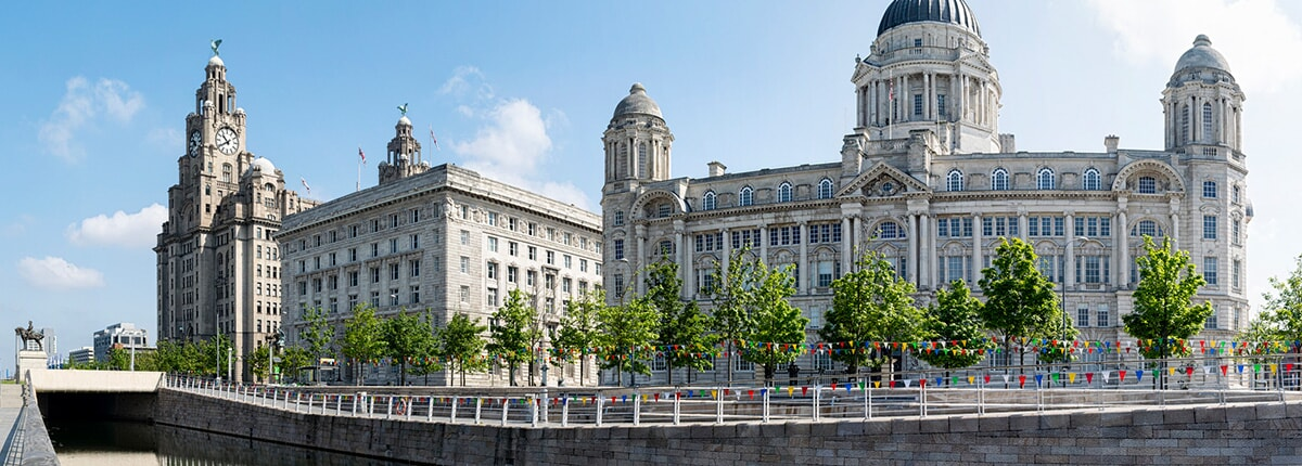 the three graces as seen by the waterfront in liverpool, england
