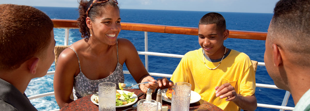 family enjoying food at lido on carnival cruise ship