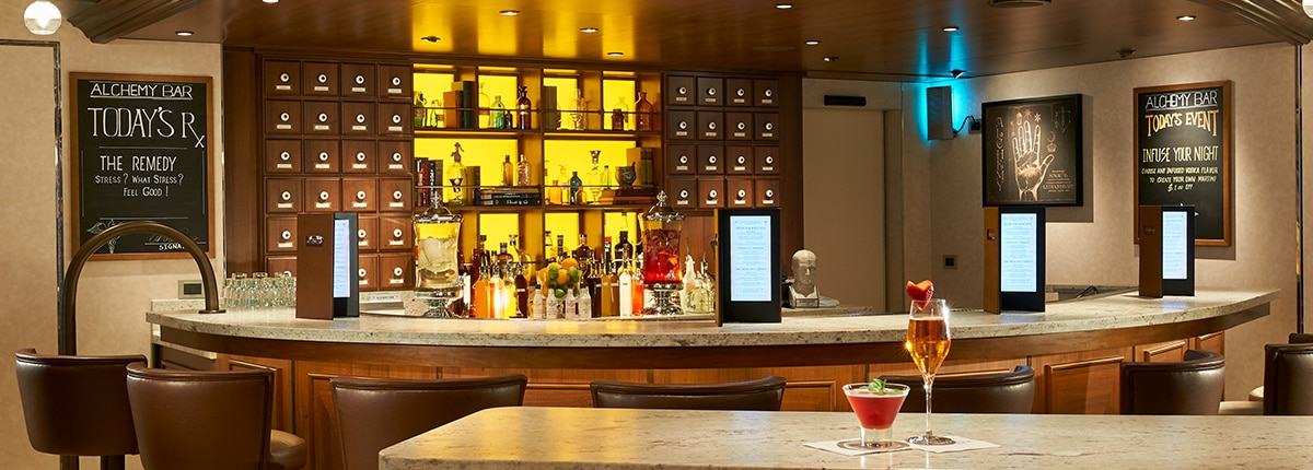 grab a cocktail at the alchemy bar on carnival