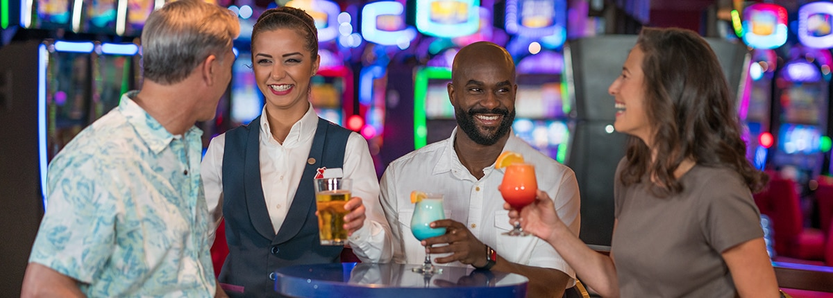 guests enjoying the drinks on us program at the carnival cruise line casino
